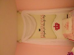 DIY cheap canopy bed. Towel Ring $5.00 a piece and Window Scarf $11.00