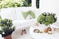 Covered white sofa with pops of green accessories