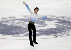 Olympic champion Yuzuru Hanyu grabbed the lead in the short program at the NHK Trophy on Friday night with a world-record score of 106.33 points. Skating b