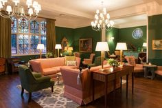 A dog-friendly country weekend at Burley Manor (pink velvet chairs and green walls)