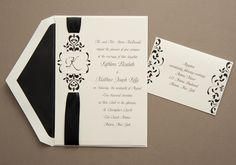 Black satin ribbon is laced through a die-cut surrounded by beautiful scrollwork~Ribbon Wedding Invitations by The Purple Mermaid