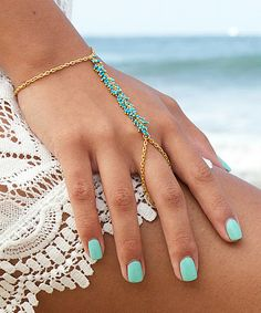 Another great find on #zulily! Turquoise & Gold Hand Chain #zulilyfinds