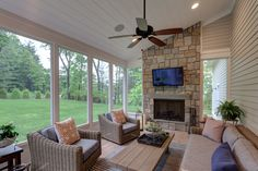 A screened-in porch with indoor-outdoor furniture, fireplace, ceiling fan, and TV hookup. Indoor Outdoor Furniture, Indoor Outdoor Living, Mobile Home Addition, Screened In Patio, Patio Roof, Porch Fireplace, Cape Cod Style House, Sunroom Addition, Custom Home Builders