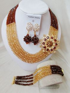 Find More Jewelry Sets Information about 2015 New Gold Flower Brown Crystal Bead Nigerian Wedding Necklace Bracelet Clip Earrings African Beads Jewelry Set CPS 172,High Quality Jewelry Sets from Alisa's Jewelry DIY Store on Aliexpress.com