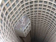 Ponte City is a skyscraper in Johannesburg, South Africa. It was built in 1975 to a height of 173 m ft), making it the tallest residential skyscraper in Africa. Brutalist Buildings, Abandoned Buildings, Abandoned Places, V Video, Dieselpunk, South Africa, Pictures, City Apartments, Spaces