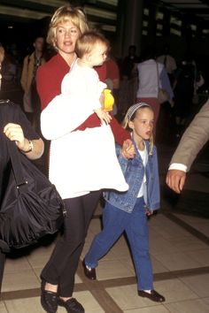 Melanie Griffith with her daughters Dakota Johnson, and Stella (Griffiths's daughter with Antonio Banderas) at LAX on May 17, 1997.  -Cosmopolitan.com