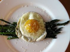 Egg over asparagus and parmesan via XO Breakfast. Would be great with a crusty oiled salted grilled chunk of bread.    http://xobreakfast.com/post/620243451/fried-egg-over-roasted-asparagus-with-parmesan