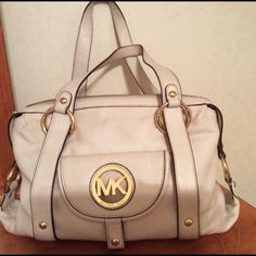"Michael Kors white leather handbag This beauty is pre-loved but still in great shape! White leather with gold hardware. Measurements are 13""w x 10""h x 5"" deep. Handle drop is 9"".  It has an outside front snap pocket, outside back pocket, an inside zip pocket and four inside slip pockets. Lots of space for your things! Michael Kors Bags"