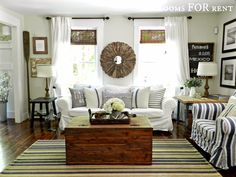 A Farmhouse with a beachy cottage vibe, filled with distressed wood tones, and relaxed slip covers, this family friendly room is enjoyed by all.  ~rooms FOR rent~: Summer Home Tour {2014}