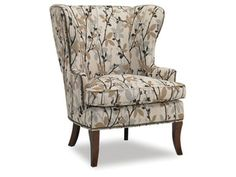 This transitional wing chair comes standard a blendown plus seat cushion and 1/2'' brass nailhead trim.
