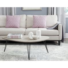 Give your living room a high end designer look with the dramatic elliptical shape of the Wynton coffee table.