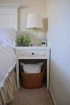 Take advantage of small spaces under tables by using stylish baskets as extra storage. We have a great range of baskets available here http://www.virginiahayward.com/empty-hamper-baskets/