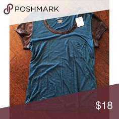 Calvin Klein Tee Turquoise Tee w/ pleather accents on collar and sleeves. Calvin Klein Tops Tees - Short Sleeve