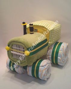 Tractor diaper cake      About 60 Diapers size 1 (8lb to 14lb)      Fleece Blanket      Receiving Blanket      Pair of Baby Socks      Bodysuit      Dishwasher Basket