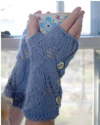 I wanna knit this in a lush green yarn with shiny bright buttons. Mmm, buttons.