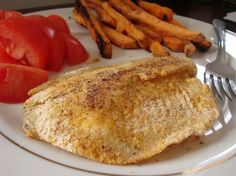 Corn meal breaded fish. A sliced roma tomato and oven-fried sweet potato fries rounds out this meal nicely.