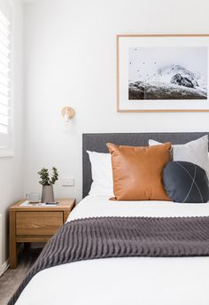 Explore this elegant renovated ski retreat in Jindabyne : Cosy bedroom with grey bedhead, white walls, timber side table and pops of colour. Elegant Home Decor, Grey Bedroom Decor, Grey Bedroom With Pop Of Color, Home, Home Bedroom, Elegant Homes, Chic Bedroom, Simple Bedroom, White Walls