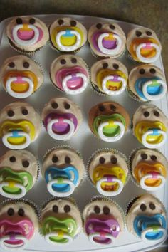 Adorable Pacifier Cupcakes ~ Baby Shower  ~ no link to recipe was available but @LindaClukey the originator of this creative idea and owner of the picture, says It's just upside down chocolate chips & pacifiers. The skin tone is achieved w/just a tiny touch of copper food coloring. ~ Wonderful idea Linda!  So simple and a great conversation starter.