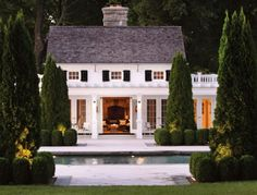 I love the tall arbovities surrounded by the boxwoods and lighting