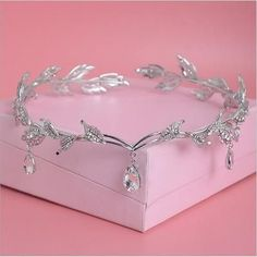 Product Details - Item Type: Hairwear - Fine or Fashion: Fashion - Shape\pattern: Plant - Material: Crystal - Style: Trendy - Metals Type: Zinc Alloy - Type: Headbands - Process: Bridal Tiaras and Crowns - Design: Hair Jewelry Estimated Delivery Time: 2-3 Weeks