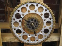 A dirt bike clock for my nephew who loves riding. Made from the rear sprockets and chain of a dirt bike (not sure the brand).