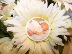 Interesting christening idea....a photo flower center