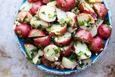 A recipe for a vegan and gluten free potato salad with parsley, garlic, scallions, lemon juice, olive oil and spices.