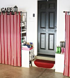 Cover unattractive shelving in a garage with simple curtains on rods, especially if the room is serving double-duty as a mudroom or entryway, to create a less cluttered-looking space