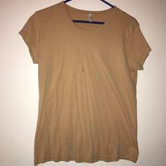 American Apparel T shirt There is no visible stain, I think the lighting just makes it look that way. Size XL worn once with a costume. American Apparel Tops Tees - Short Sleeve