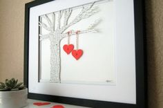 Put the lyrics from your first dance or your vows on paper, cut it out in the shape of a tree and have your initials hanging from hearts on a branch