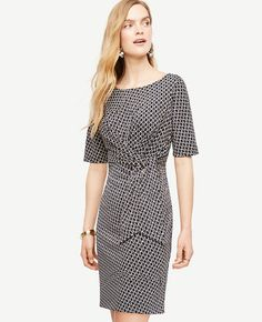 """Punctuated with a modern side tie, our refined matte jersey dress always commands a perfectly pulled together look. Jewel neck. Short sleeves. 21"""" from natural waist."""
