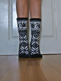 Hand-knitted Black White Wool Socks Scandinavian Fairisle Floral Christmas. $42.50, via Etsy.
