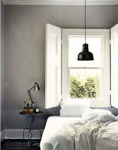 love the punchy contrast the black lamp, shade + grey walls add to the white finishes + linen. super cool!