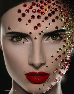 Gorgeous natural make-up with red lips adorned with creatively placed gems.