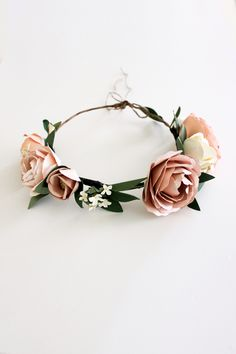 Handmade paper flower crown. Perfect for your flower girls, bridal shower  or bachelorette accessories, and for keep sake.We could also customize the  flowersin your specific wedding colors. Hemp yarn tie at the end. 100% Handmade  If you would like to customize this piece ina different color or size,  please email info@handmadebysarakim.com. Please check our store policy for  processing time and current order status. If you need your order shipped  before our standard processing time…