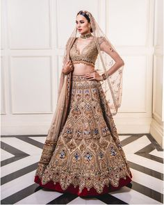 Beige and gold heavily embroidered Tarun Tahiliani bridal lehenga. Ever wondered what is Tarun Tahiliani Lehenga Prices? Check out the latest bridal collection along with new lehenga pictures and prices. Women's Dresses, Indian Dresses, Fashion Dresses, Indian Wedding Outfits, Bridal Outfits, Bridal Dresses, Flapper Dresses, Wedding Dress, Designer Bridal Lehenga