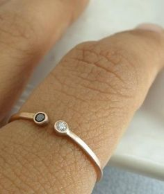 his and her birthstone ring.... Cute idea. I'd want two, one with the girls' and one with the boys' birthstones!