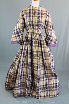 "Mid 1850s, plaid dress, pagoda sleeves, silk, very lightweight; bodice lined with brown linen/cotton fabric; buttons, front hook & eye closure; back closure on skirt; bust: 34""; waist: 29""; skirt length: 41""; skirt waist; 32"""