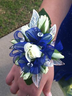 Blue and silver wrist corsage. Flowers of Charlotte loves this! Visit us at flowersofcharlotte.com