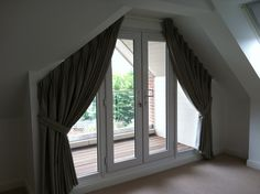 another double pleat curtain for a triangular window,