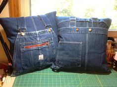 """Denim Pillow:  A friend ask me to make pillow covers from a dear uncles old overalls.  I cut open the legs to create the 18"""" pillow and then cut off the bib fronts, straps, and back pockets and sewed them back on the pillow pieces.  They will be Christmas gifts for his widow and niece."""