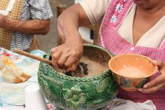 Dishing up chocolate atole, a thick, warm drink made with chocolate and corn
