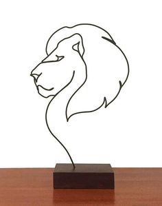 """Known as """"the great Lion"""" of The Lion, the Witch and the Wardrobe, he is Aslan Single-wire Sculpture Tanguile Wood Commissioned Piece Wire Crafts, Metal Crafts, Wire Art Sculpture, Sculptures, Metal Drawing, Art Deco Tattoo, Wrought Iron Candle Holders, Metal Art Projects, Steel Art"""