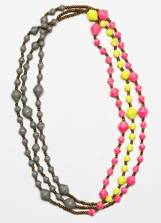 This Mukisa Necklace - Neon makes the neon trend accessible for all ages and styles.  The purchase also helps artisans in Uganda find their path out of poverty.
