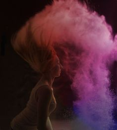 Stunning cloud created by the powder, as a result of the model tossing her hair back. One can almost imagine the previously looked at steam clouds as they look at the whispy shapes.