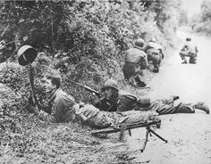 Checking for snipers in the Bocage, Normany 6 June 1944