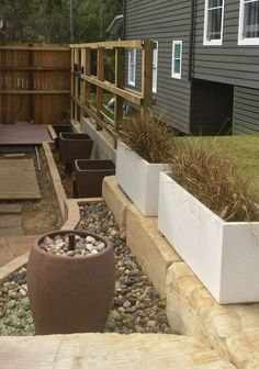 Supports in for arbour posts, post in situ to confirm preferred layout.  To be done - finalise lighting, clad & render fences, ramp from existing decking to sandstone path.