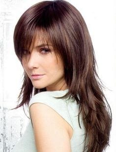 Love this long layered haircut with bangs