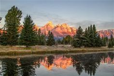 """""""Teton Sunrise"""" by Thomas Steele has been entered into November's Featured Artist Contest. Go here to vote: http://woobox.com/mtefsx"""