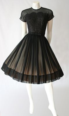Black chiffon and lace 50s dress. I like the nude underneath - would be good to have accessories in the same colour.